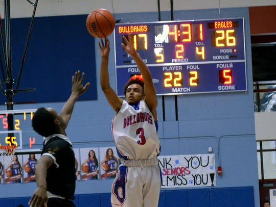 Las Cruces High's Markus Collins takes a 3-point shot