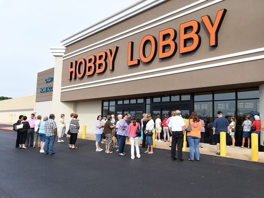 Area residents wait outside the new Hobby Lobby in Mountain Home for the store's grand opening on July 10. Several new business openings excited area residents in 2014, including Hobby Lobby, Buffalo Wild Wings and the new Harps location.