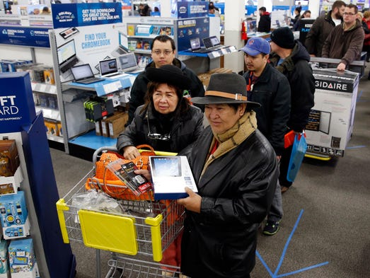 Shoppers line up for purchases at a Best Buy store