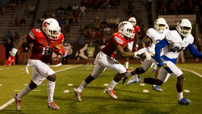 Running back Tre Nation, 12, runs toward the end zone in the fourth quarter of Austin Peay's game against Morehead State.