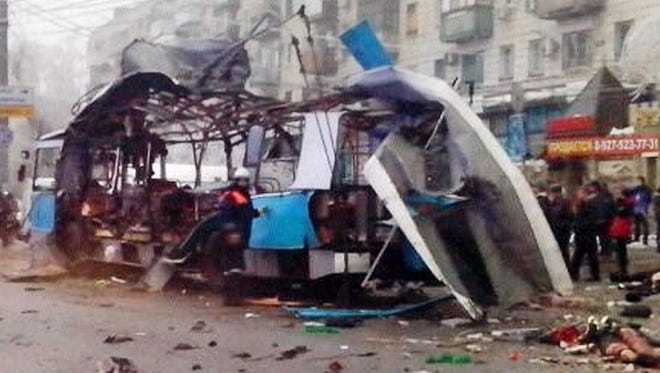 A handout picture taken and released by the Volgograd regional Interior Ministry department's press service shows the wreckage of a trolleybus following a suicide attack that killed at least  14 people in the southern Russian city of Volgograd. The deadly bombing was caused by a male suicide bomber, investigators said.