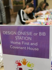 Franklin Elementary students design onesies and bibs for young mothers and their newborns as part of a districtwide community service effort on March 27.