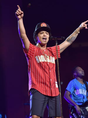 Bruno Mars performs onstage during Bruno Mars: 24K Magic World Tour at Madison Square Garden on September 22, 2017 in New York City.