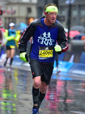 Chambesburg's Paul Sick competes in the rain-soaked Boston Marathon on Monday. Sick, 65, completed the race in 4:11:58.