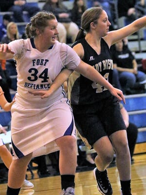 Fort Defiance's Julia Frazier (34) loves basketball, but won't compromise her religious beliefs by playing in shorts.