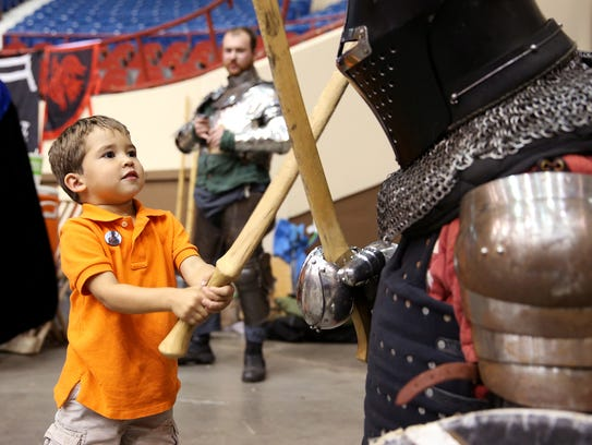 Stephen Nance, 3, fights a knight at San Angelo Comic