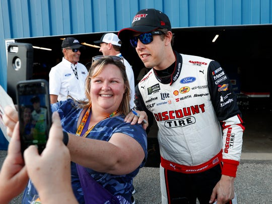 Brad Keselowski poses for a photo after winning the pole for the NASCAR Cup Series auto race at Michigan International Speedway in Brooklyn, Mich., Friday, Aug. 9, 2019. (AP Photo/Paul Sancya)