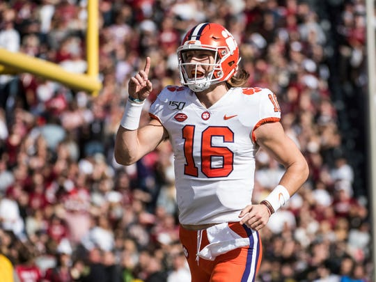 Clemson quarterback Trevor Lawrence (16) celebrates the a touchdown against South Carolina during the first half of an NCAA college football game Saturday, Nov. 30, 2019, in Columbia, S.C. (AP Photo/Sean Rayford)