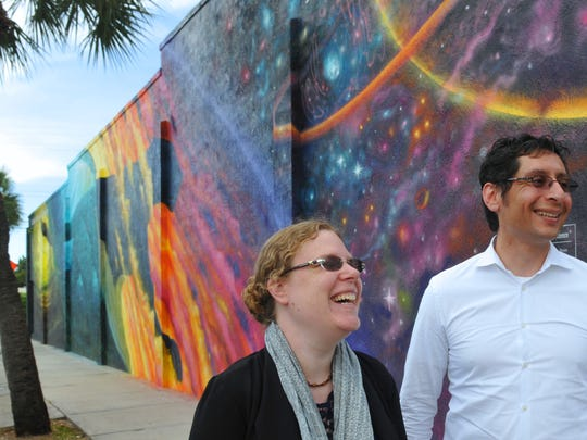 Naomi Mirsky, principal of Willow Street Capitol, and Miguel Rivera, founder and principal, are planning to develop a boutique style hotel in partnership with Duke Hospitality. It would be located at what is now a city owed parking lot behind Meg O' Malley's. Behind them is the new Florida Tech mural by artist Christopher Maslow.