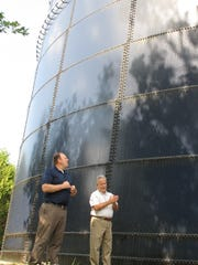 Jim Fay, right, general manager at Champlain Water