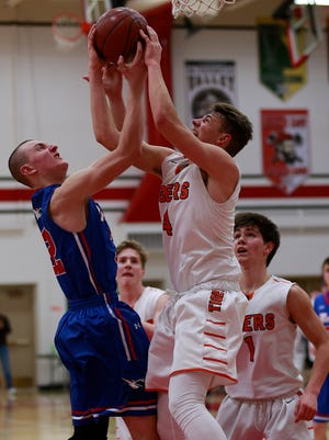 Merrill's Caleb timm(32), left, and Marshfield's Reed Miller(4), fight for the rebound ball Thursday, March 8, 2018, during the WIAA Sectional Semi-final boys basketball game match at Wausau East High School, in Wausau, Wis. T'xer Zhon Kha/USA TODAY NETWORK-Wisconsin