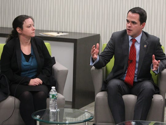 State Senator David Carlucci and Marcie Kobak, supervising attorney - litigation, Legal Services of the Hudson Valley participate in a panel discussion of cashless tolling issues on the Gov. Mario Cuomo Bridge at The Journal News in White Plains Jan. 9, 2018.