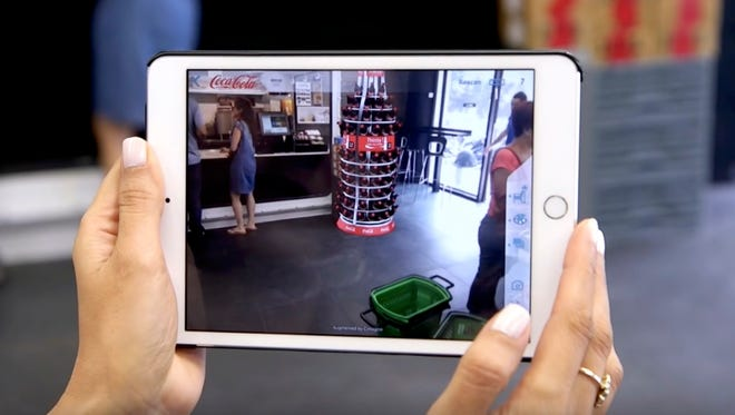 Cimagine helps retailers and customers visualize through Augmented Reality what a product will look like in a location. In this case, the Coca-Cola unit is seen via AR