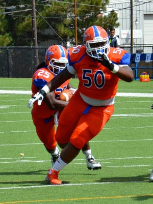 Louisiana College sophomore left guard Jamarcus Fitzpatrick (50) blocks for Aurren Cooksey.