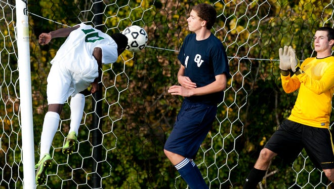 Seen in action last season, Hussein Hussein, left, leads a veteran Rice group into the high school boys soccer season.