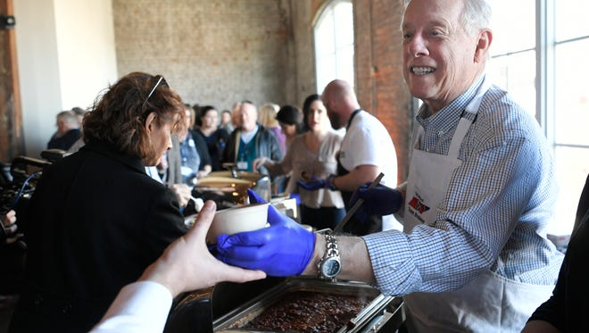 U.S. Senate candidate and former Tennessee Gov. Phil Bredesen serves chili to supporters during a campaign event at Acme Feed & Seed on March 3, 2018.