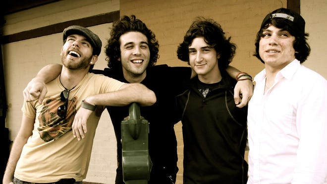 TANDEM, with lead singer River Gibson, second from left, plays its final two shows this weekend.