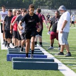 Elmira High School football players participate in the first practice of the season Monday morning at Ernie Davis Academy's Marty Harrigan Field.