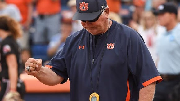 Auburn softball coach Clint Myers delivers a fist pump after the 2-1 win over Jacksonville State in the opening round game of the NCAA Regional on May 20, 2016.
