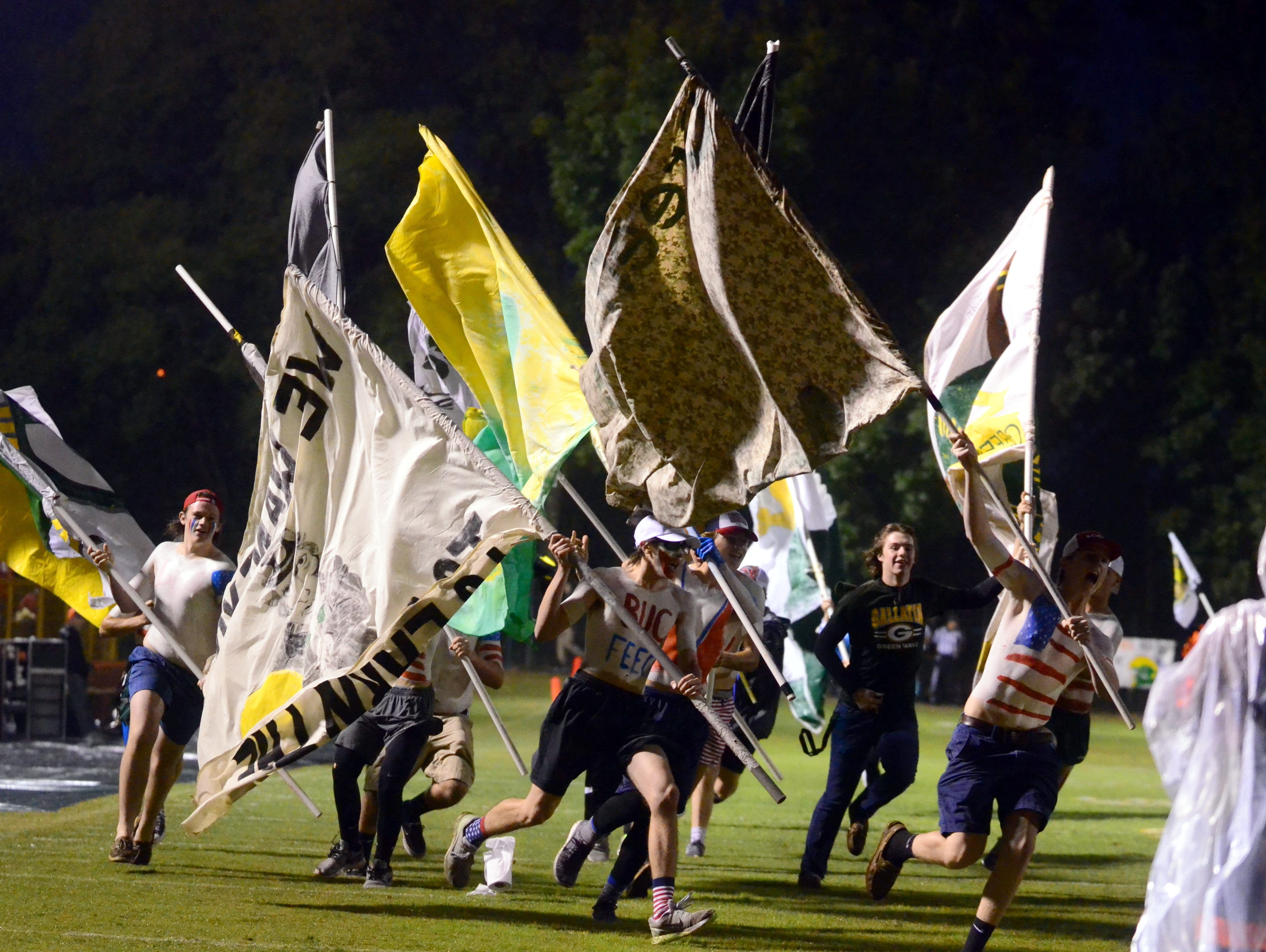 Gallatin High students carry flags on the field prior to FridayÕs game against Beech on Friday, September 30, 2016.