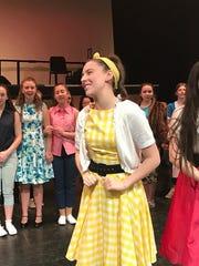 """Tori Grossman, in yellow, as Ursula in Valhalla High School's """"Bye Bye, Birdie."""""""