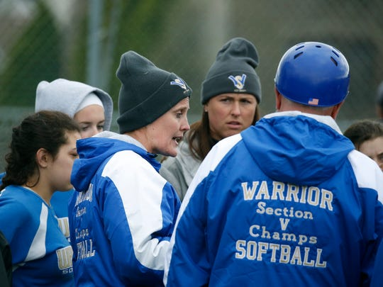 If a game is lopsided and embarrassing to her team's opponent, Webster Schroeder head coach Meaghan Keil, left, will at times instruct her runners to leave base early and make an intentional out.