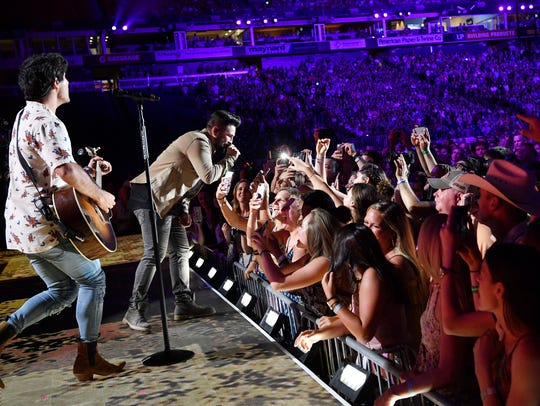 Dan + Shay get close to their fans at the CMA Music