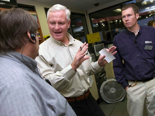 Jimmy Haslam, center, president and CEO of Pilot Travel Centers, visits with managers Gary Jones, left, and Jim Kennedy on Nov. 16, 2010, at the Flying J Travel Center on Watt Road in Knoxville. Pilot Travel Centers and Flying J merged in June 2010, with the company now operating more than 550 travel centers across North America.
