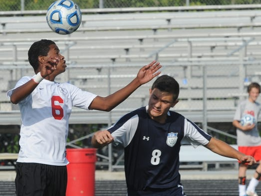 Richmond's Denis Herrera wins the ball against Franklin County's Isaiah Holland during Thursday's game at Lyboult Field.
