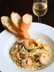 Garlic Shrimp Linguine at Caffe Classico, sauteed in a garlic white wine butter sauce, with pine nuts, baby spinach and fresh asiago. October 15, 2014