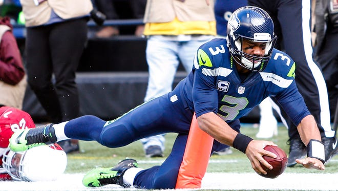 Seattle Seahawks quarterback Russell Wilson (3) dives for the end zone against the Arizona Cardinals.