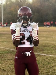 Zack Dobson poses for a photo on a football field in November 2016. Zack is attending Middle Tennessee State University this fall on an athletic scholarship.