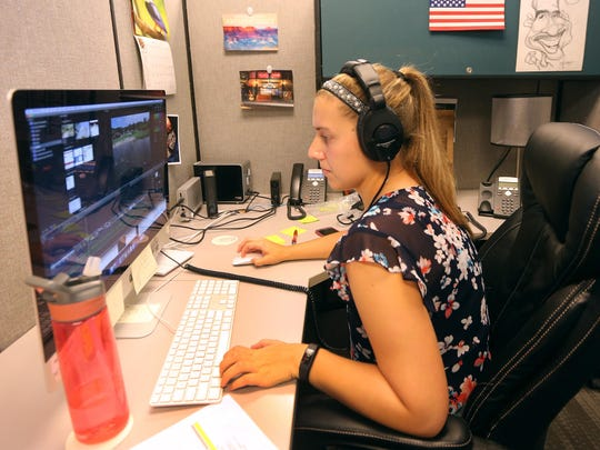 Video editor Nicole Polle at her work station at CGI Communications.