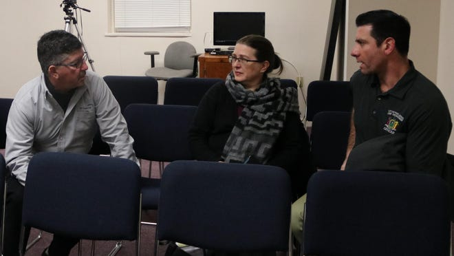 David Rivera, right, chats with Jim Farr, city engineer, and Valerie Maginsky, executive director of the Port Jervis Community Development Agency, at a Common Council meeting in January 2019, around the time Rivera's legal troubles began. Farr is now performng Rivera's duties as city building inspector.