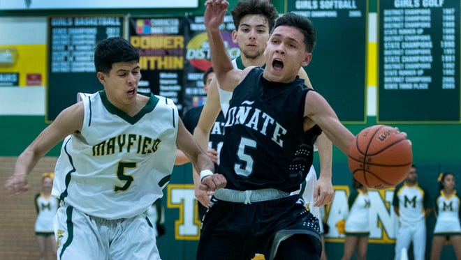 Oñate 's Ricky Lujan gets fouled by Mayfield's Mark Mocias as he is trying to break the press Friday night at Mayfield High School.