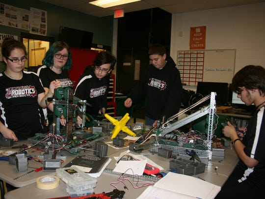 Elmira High School's VEX Robotics team, in its second year, prepares for competition at a Jan. 12 meeting.