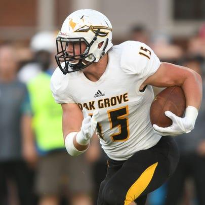 Oak Grove High School defensive end Jack Harris takes
