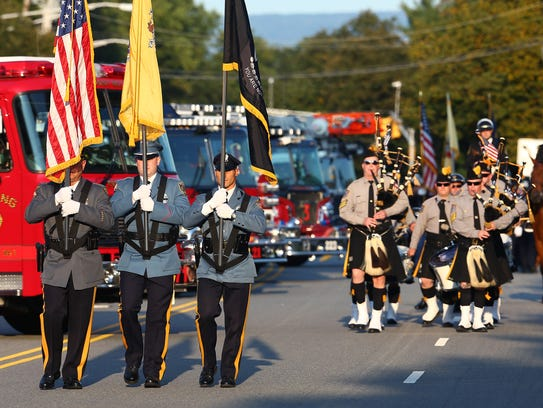 A color guard marches up West Hanover Avenue to the