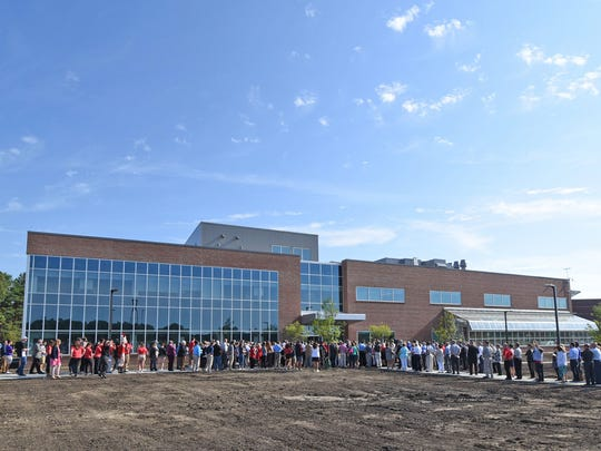 Visitors gather outside the new Science and Engineering Building at the Ohio State University/Marion campus on Tuesday for the ribbon cutting ceremony.