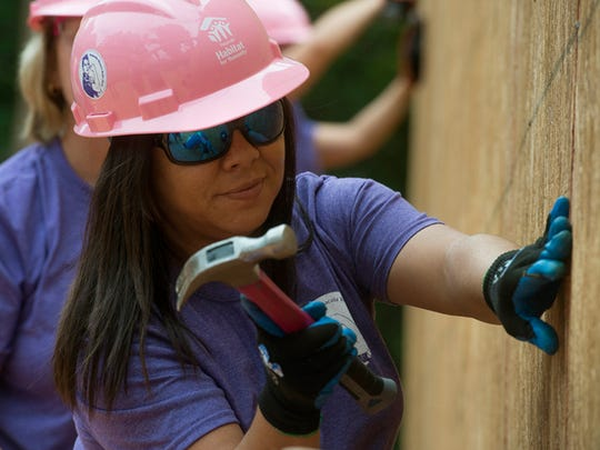 Jennifer Ness represents Gulf Power, on the women's build for the Habitat for Humanity Tuesday Oct. 6, 2016. All women construction crews from Baptist Hospital and Wind Creek Casino also took part in the build.