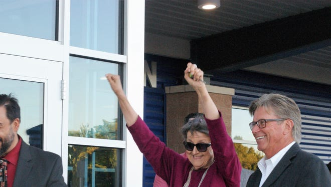 In a joyous, occasionally tearful ceremony on Monday evening, the new Deming High School hosted a ribbon-cutting ceremony followed by guided tours of the brand-new building, parts of which are still concluding construction. Cutting the ribbon, from left, were Superintendent Arsenio Romero and former Superintendents Harvielee Moore and Dan Lere.