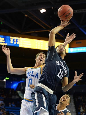 Micah Seaborn goes in for a layup at UCLA on Friday night. Monmouth University defeated the Bruins, 84-81, in overtime.