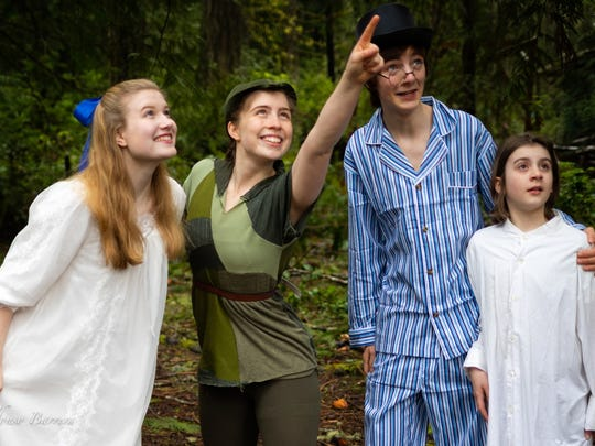 Peter Pan (Anna Vizzare, second from left) shows the way to Neverland to the Darling children, (from left) Wendy (Juliette Jones), John (Oliver Girouard) and Michael (Nigel Kelley).