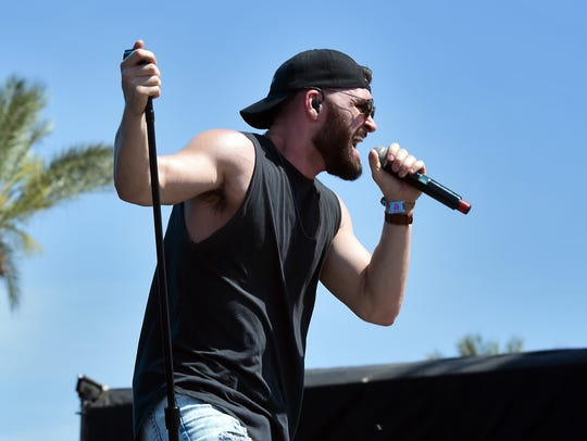 Singer Dylan Scott performs on the Toyota Mane Stage