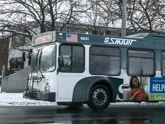 A SMART bus headed to Southfield drives down 8 mile road in Detroit in December 2017.