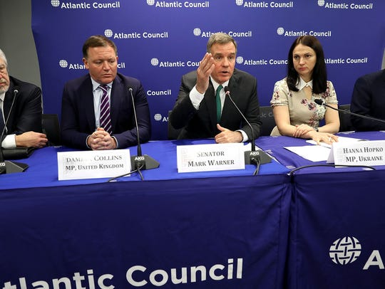 U.S. Sen. Mark Warner, D-Va., (center) is joined by,
