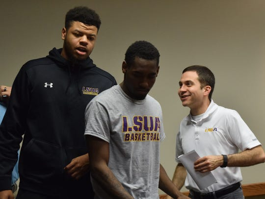 LSU at Alexandria men's basketball coach Larry Cordaro (far right) talks to several of his basketball players at a press conference announcing that LSUA and the City of Alexandria will be hosting the Red River Athletic Conference  basketball tournament in March 2017 at the newly renovated Rapides Parish Coliseum.