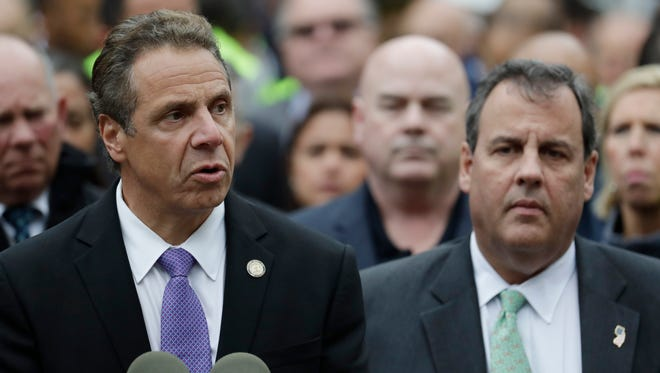 New York Gov. Andrew Cuomo, left, speaks during a news conference Sept. 29 at the Hoboken Terminal as New Jersey Gov. Chris Christie, right, listens in Hoboken, New Jersey.