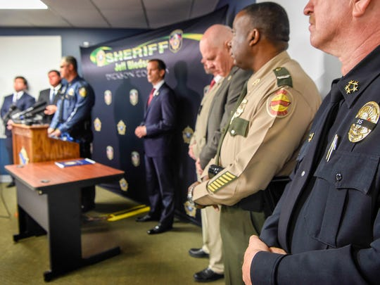 Sheriff Jeff Bledsoe is joined by other law enforcement to announce federal and state charges related to the death of Dickson County Sheriff's Sergeant Daniel Baker at a press conference at the Dickson County Sheriffs Department in Charlotte, Tenn., Friday, June 8, 2018.