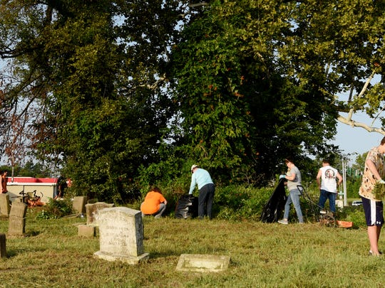 The Krewe of Centaur spent a recent Saturday morning cleaning the graveyard at St. Luke Baptist Church.